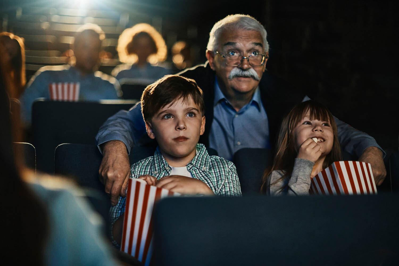 Grandpa and grandkids at the movies